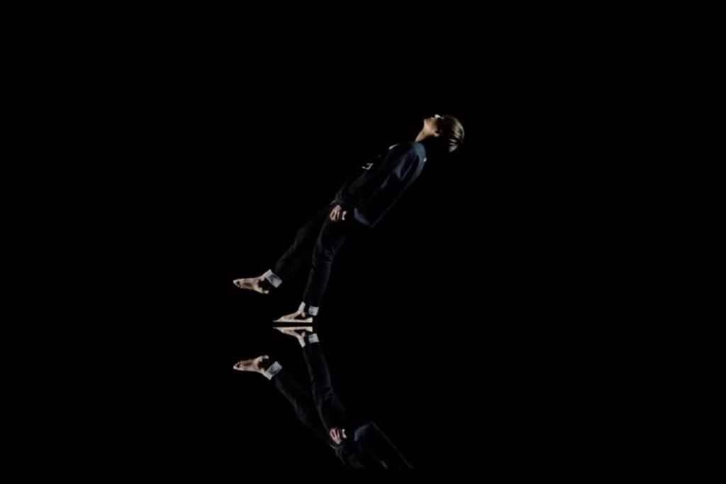 Taehyung falls calmly backwards into black water