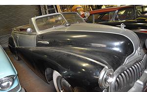 huge convertible seen in Lenny's Garage