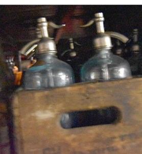 seltzer bottles in Lenny's Garage