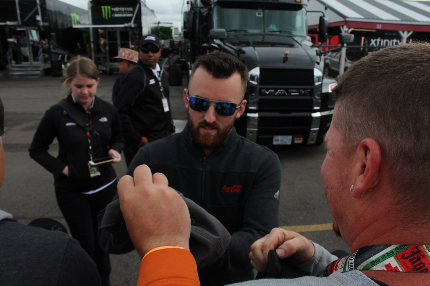 Austin Dillon signs autographs ahead of the 2018 Pocono 400. (Tyler Head   The Racing Experts)