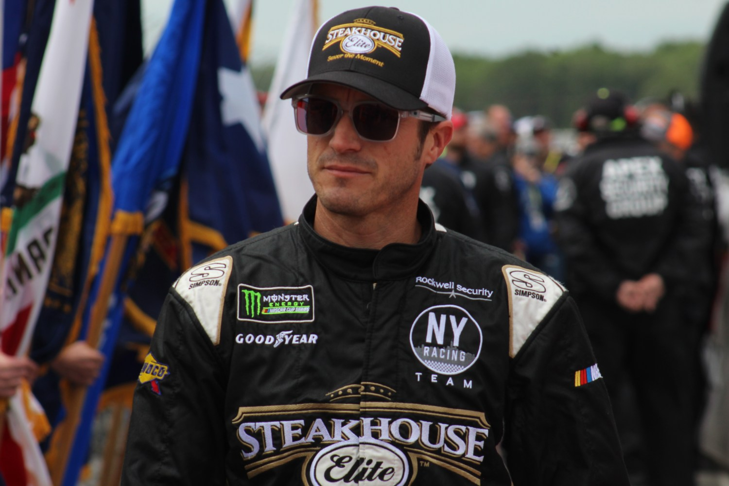 JJ Yeley walks during driver introductions for the 2018 Pocono 400. (Tyler Head | The Racing Experts)