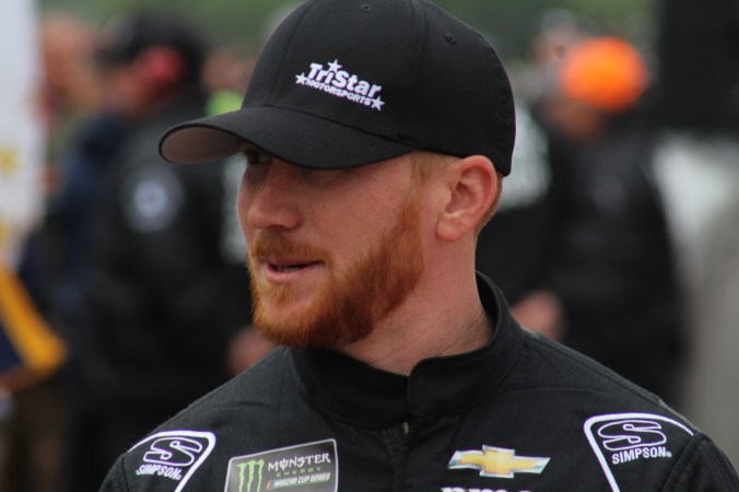 Cole Whitt walks during driver introductions for the 2018 Pocono 400. (Tyler Head | The Racing Experts)