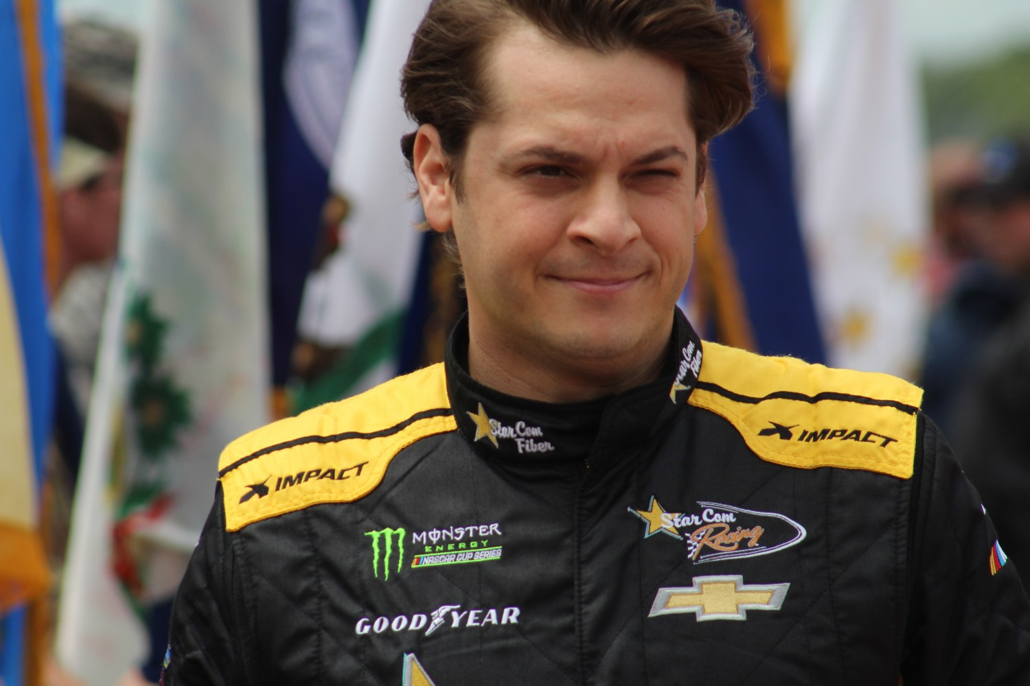 Landon Cassill walks during driver introductions for the 2018 Pocono 400. (Tyler Head   The Racing Experts)