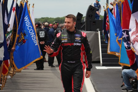 Matt DiBenedetto walks during driver introductions for the 2018 Pocono 400. (Tyler Head | The Racing Experts)