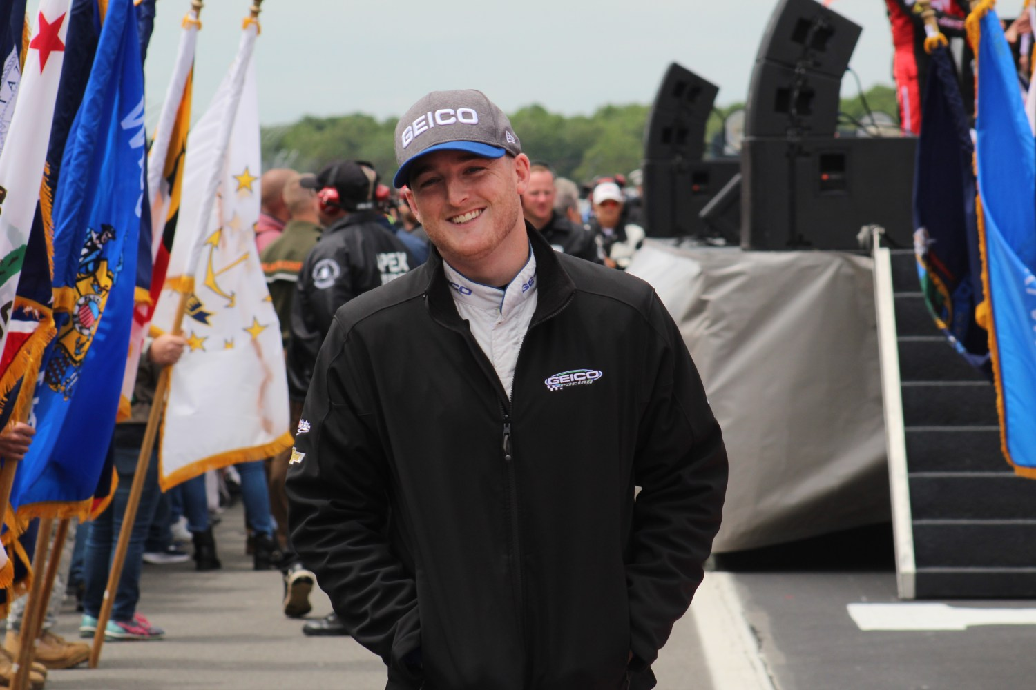 Ty Dillon walks during driver introductions for the 2018 Pocono 400. (Tyler Head   The Racing Experts)