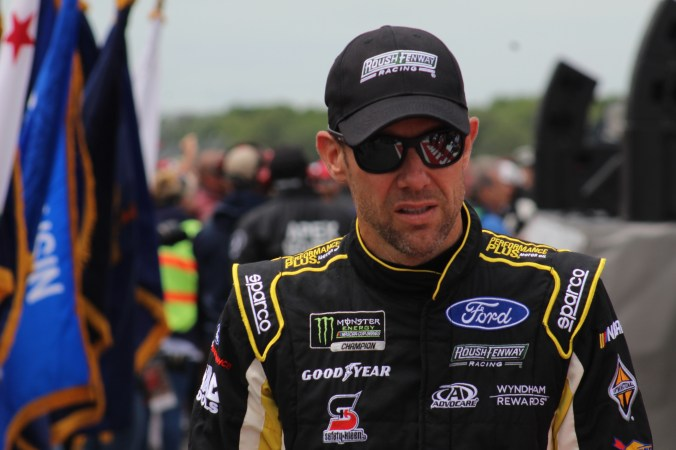 Matt Kenseth walks during driver introductions for the 2018 Pocono 400. (Tyler Head | The Racing Experts)