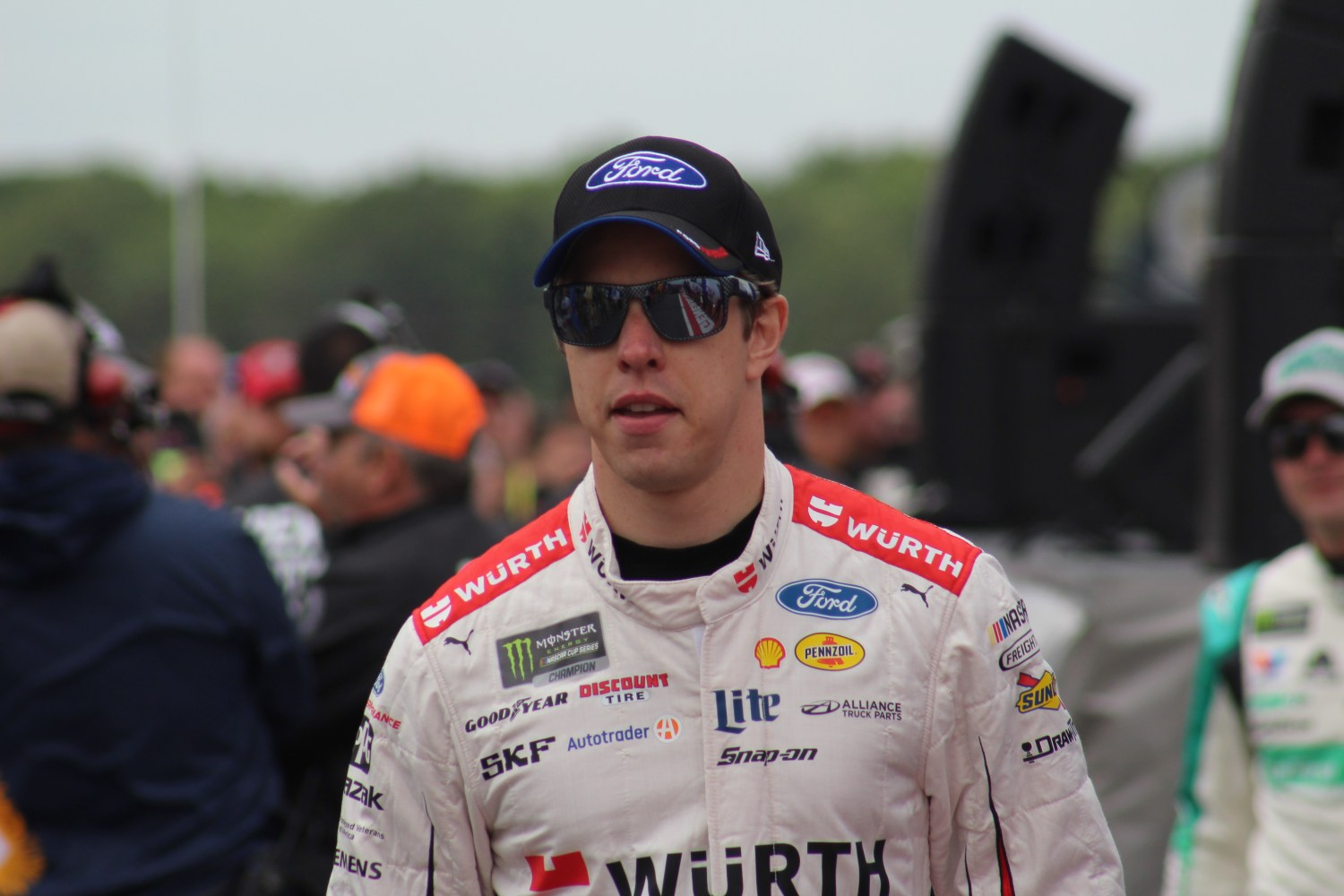 Brad Keselowski walks during driver introductions for the 2018 Pocono 400. (Tyler Head | The Racing Experts)