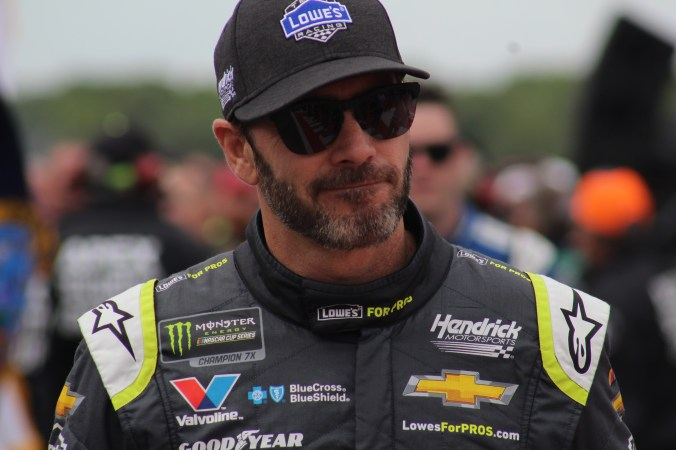 Jimmie Johnson walks during driver introductions for the 2018 Pocono 400. (Tyler Head | The Racing Experts)
