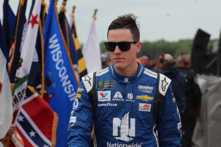 Alex Bowman walks during driver introductions for the 2018 Pocono 400. (Tyler Head | The Racing Experts)