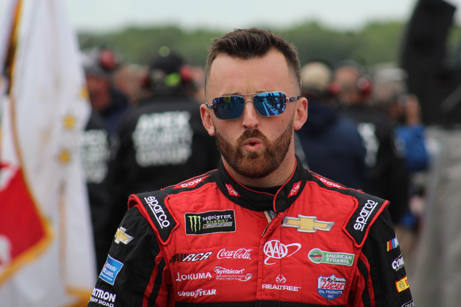 Austin Dillon walks during driver introductions for the 2018 Pocono 400. (Tyler Head | The Racing Experts)