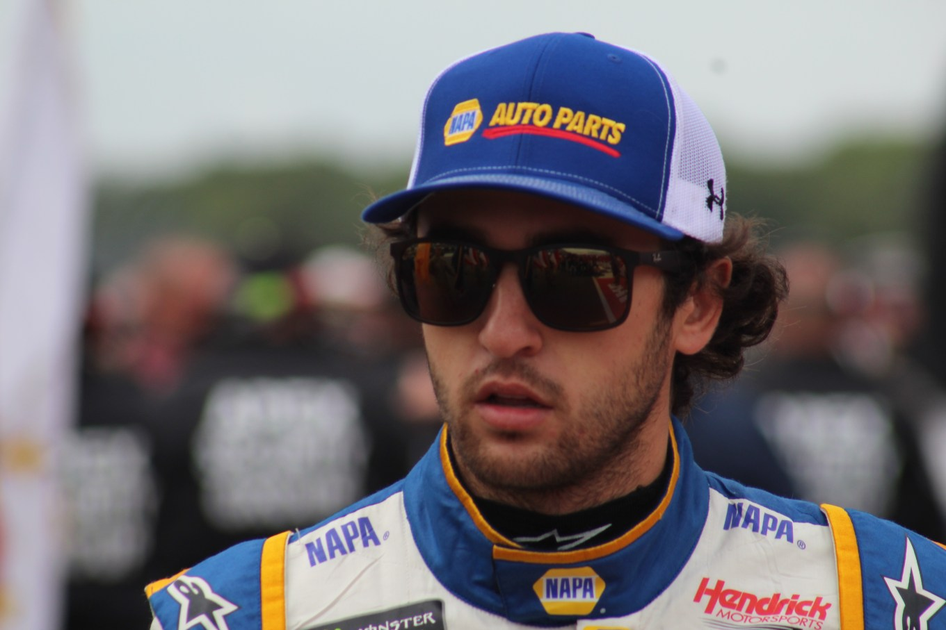 Chase Elliott walks during driver introductions for the 2018 Pocono 400. (Tyler Head | The Racing Experts)
