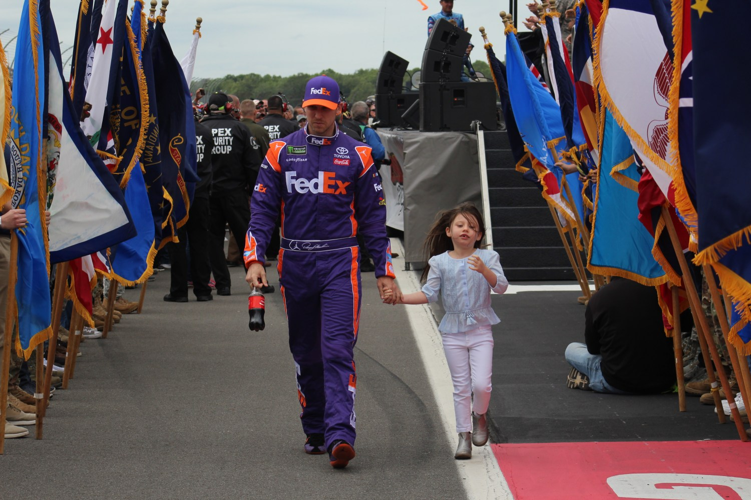 Denny Hamlin walks during driver introductions for the 2018 Pocono 400. (Tyler Head | The Racing Experts)