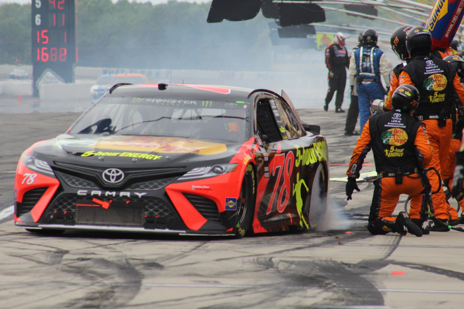 Martin Truex Jr. leaves the pits during the 2018 Pocono 400. (Tyler Head   The Racing Experts)