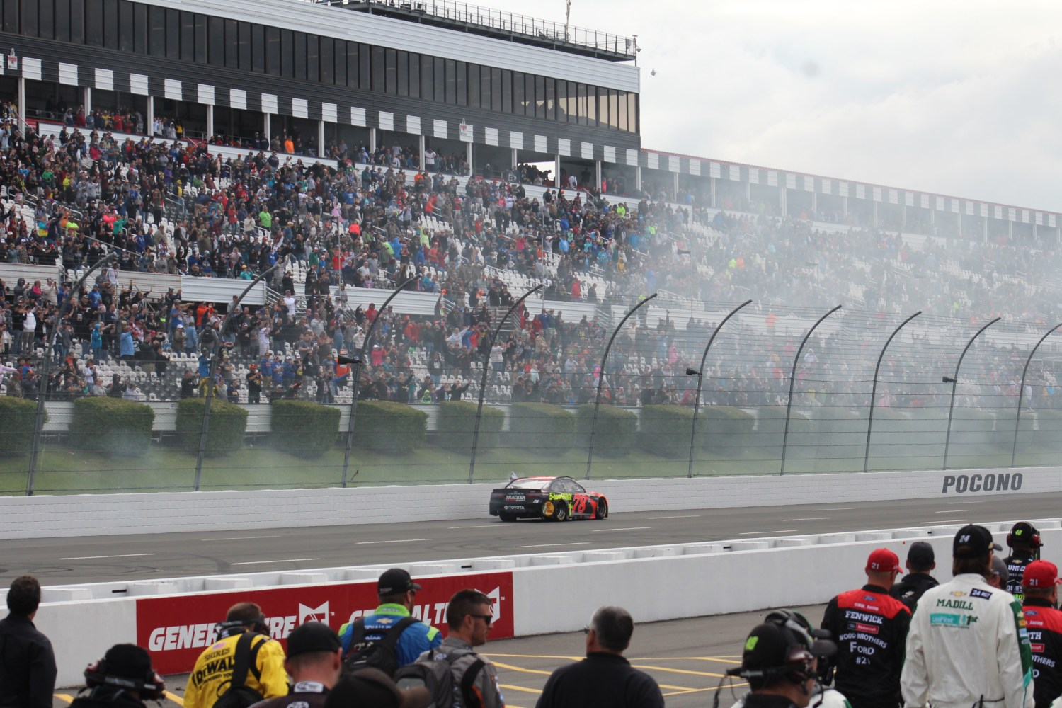 Truex passes by Pocono grandstands after victory