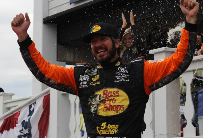 Martin Truex Jr. celebrates in victory lane.