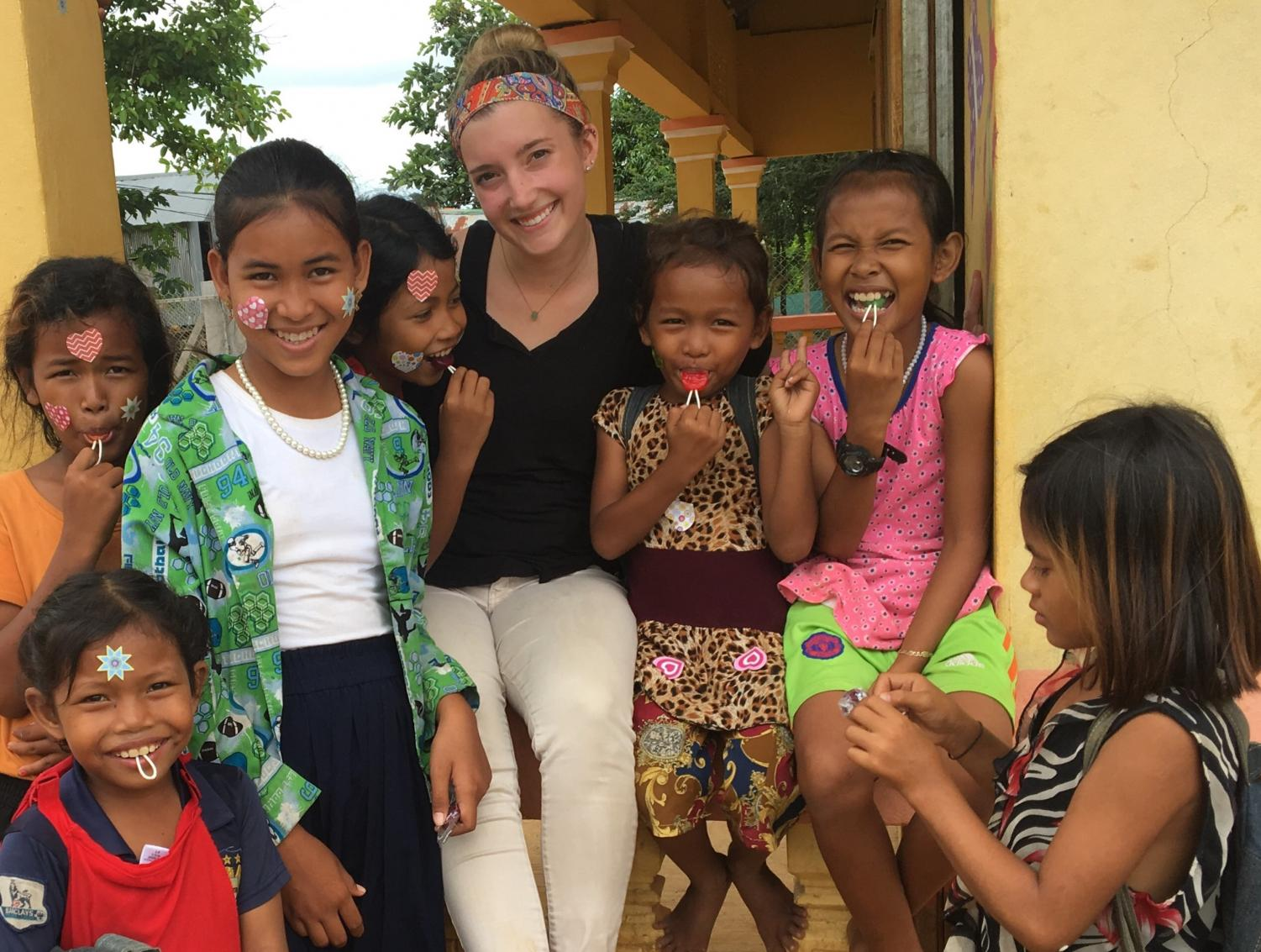 UWL Junior Margaret Finco with children in Cambodia