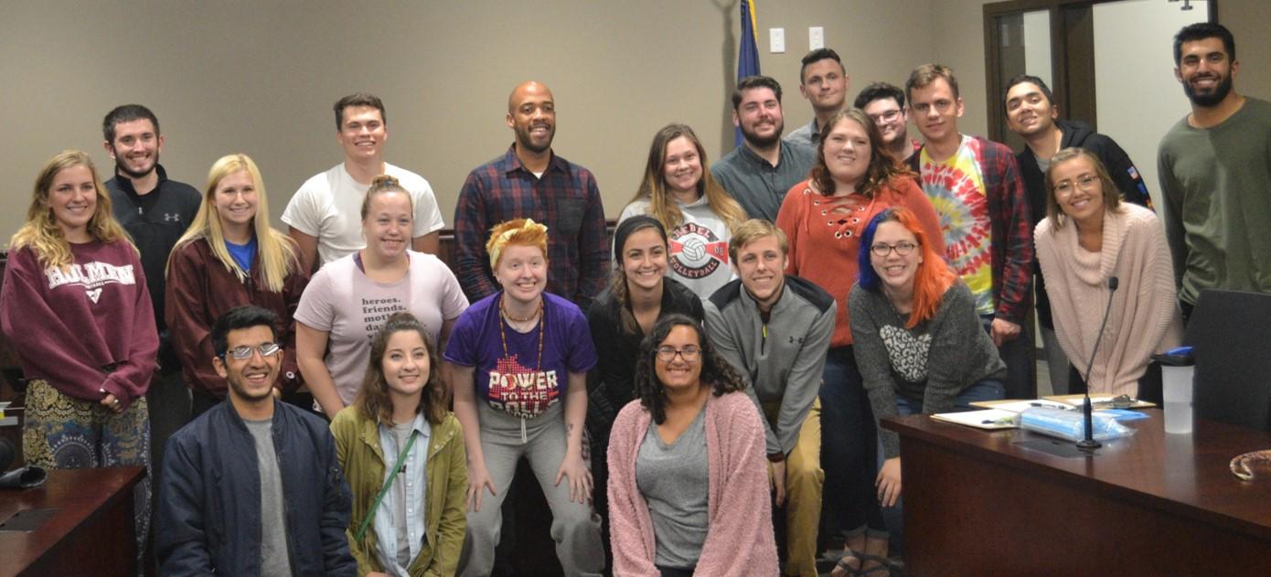 Lt. Gov. Mandela Barnes  (center) poses with UWL students ahead of the Nov. 6 election.