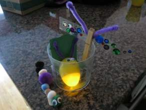 """Firefly, Caterpillar, and an """"Airplane Bug."""" Connor made the caterpillar pretty much by himself and put the sequins on the airplane bug's wings. This was his first time using glue or scissors!"""