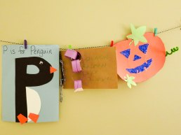 """""""P is for Penguin"""" from preschool (P, numbers), a chain for things Connor loves from Sunday school, a leaf journal we made together at JC Raulson Arboretum, and a jack-o-lantern we made together for the pumpkin patch at preschool."""