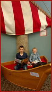 tRR 2016-04-07 E and Em in boat at the library
