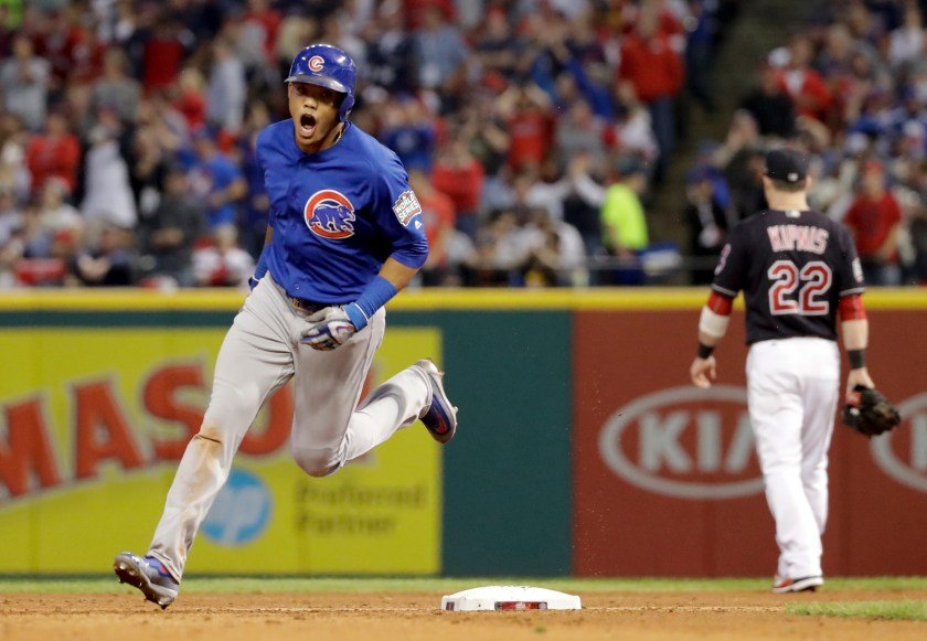 Chicago Cubs' Addison Russell celebrates after his grand slam against the Cleveland Indians during the third inning of Game 6 of the Major League Baseball World Series Tuesday, Nov. 1, 2016, in Cleveland. (AP Photo/Matt Slocum)
