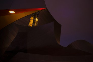 A light-polluted sky gently illuminates the stainless steel panels of the Walt Disney Concert Hall.