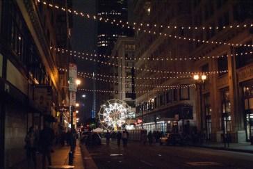 A small ferris wheel decorates Broadway at 5th Street.