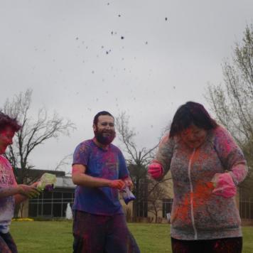 Wesleyan students throwing colors.