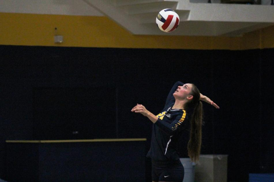 Alanna Hayhurst serves the ball against Our Lady of the Lake University.