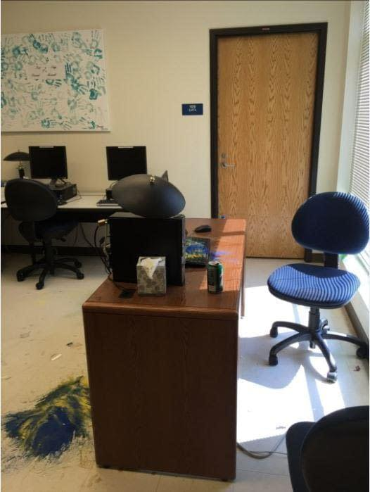 Photo courtesy of Katherine Brown.  The vandal dumped sand onto the floor and only attacked one computer.