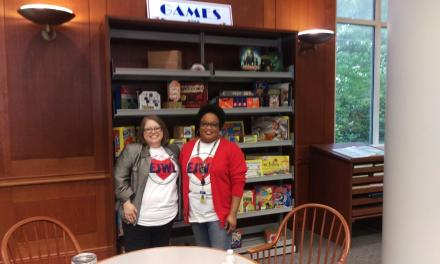 Students examine library as part of National Library Week event
