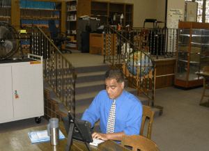 Mr. Bhatti hard at work in the library