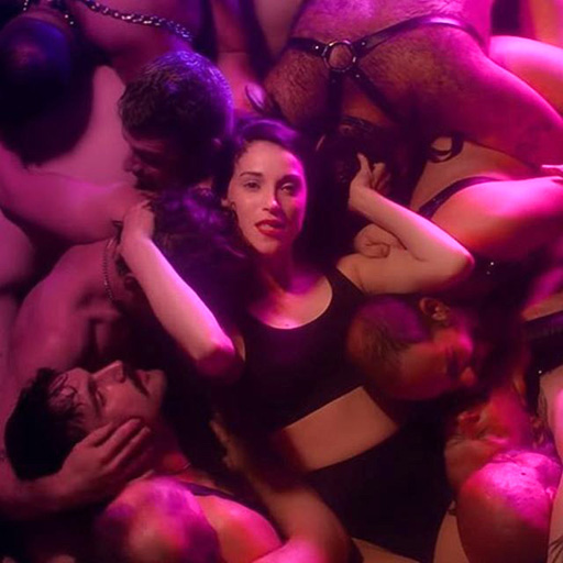 """St. Vincent (whose real name is Annie Clark) recently reimagined her song """"Slow Disco"""" into a sensual, euphoric remix and set the music video in a late night dance club."""