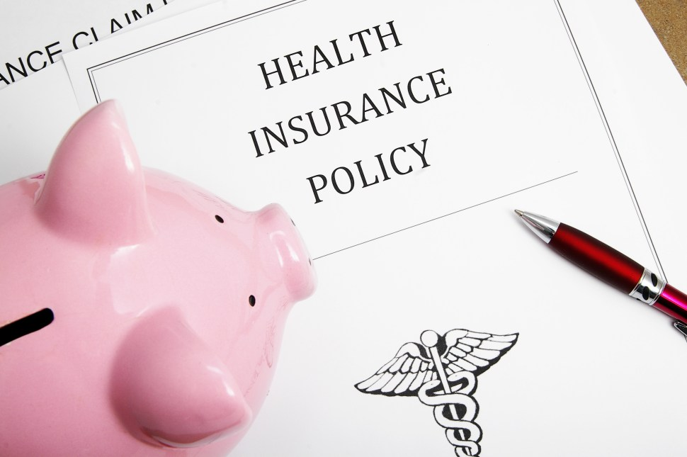health insurance policy and piggy bank