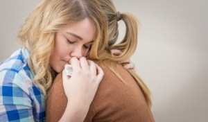 Sad female hugging another female | Cancer & Illness Counseling Services | Jennifer Levin | Therapy Heals | Pasadena, CA 91106
