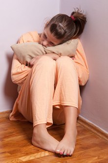 Sad girl hugging pillow, sitting in corner | Grief, Loss & Bereavement Counseling | Jennifer Levin | Therapy Heals | Pasadena, CA 91106