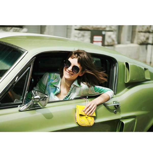 model wearing the yellow and rosé embroidered ABURY Leather Berber Mini Crossbody Bag