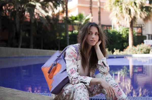 Model holding Asmaa Purple Leather Business Bag next to the pool in Marrakech