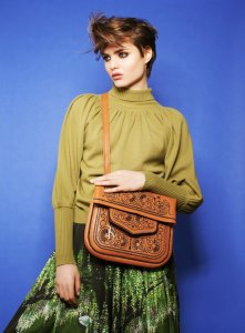 Model in green outfit front of blue wall wearing handmade Camel and Chocolate Leather Berber Bag - Shoulder Bags - ABURY Collection