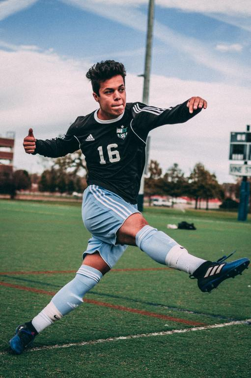 Soccer player kicking ball at South Omaha High School