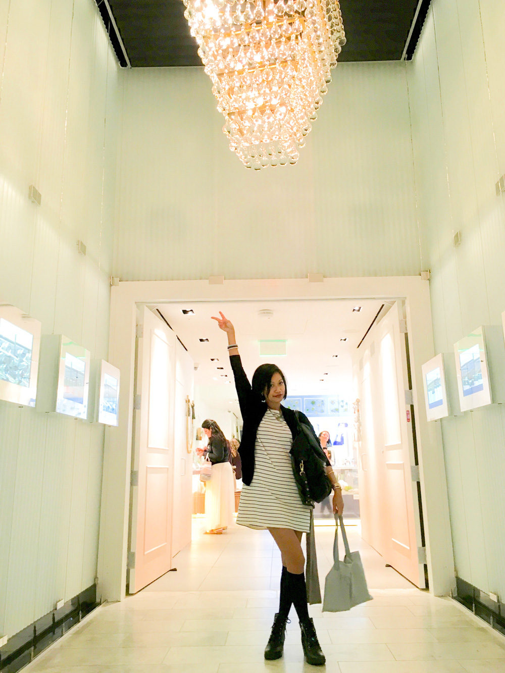 thereafterish California Diaries 06 lost vlog thumbnail  Asian woman flashing peace sign in bright hallway