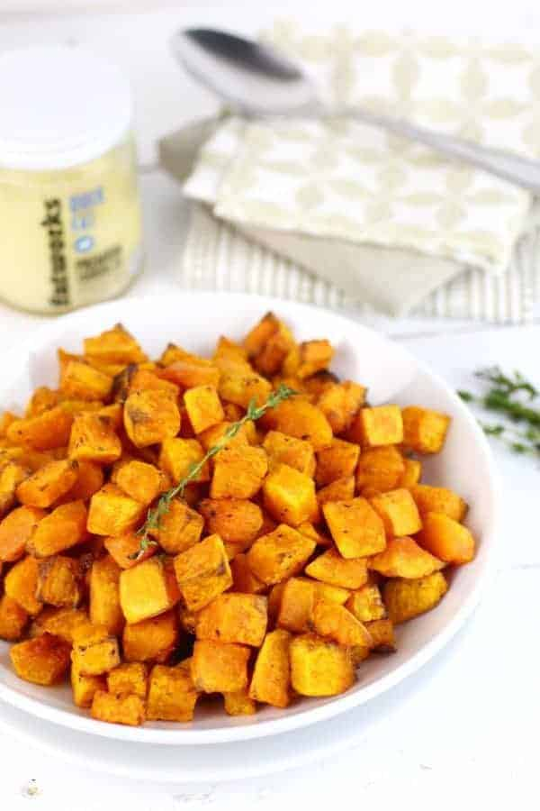 Butternut Squash Home Fries are roasted to perfection and make for a flavorsome, 4-ingredient side-dish for even the pickiest eaters! | Whole30 | Paleo | Grain-free | Gluten-free | Dairy-free | healthy side dishes | butternut squash recipes | whole30 side dishes | gluten-free side dishes | paleo side dishes | dairy-free side dishes || The Real Food Dietitians #butternutsquash #whole30recipes