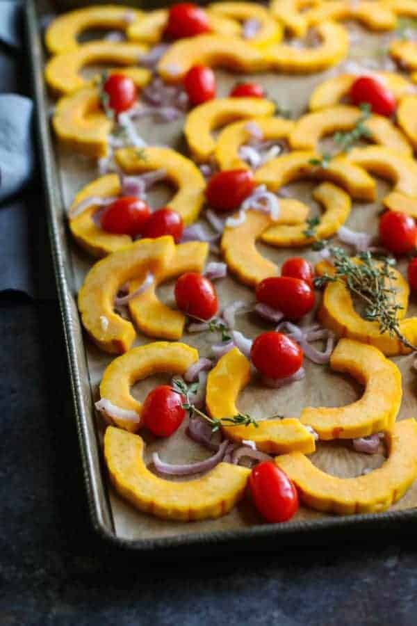 Roasted Delicata Squash with Tomatoes | healthy squash recipes | healthy side dishes | how to roast delicata squash | delicata squash recipes | Whole30 side dishes | gluten free side dishes | dairy free side dishes | paleo side dishes || The Real Food Dietitians