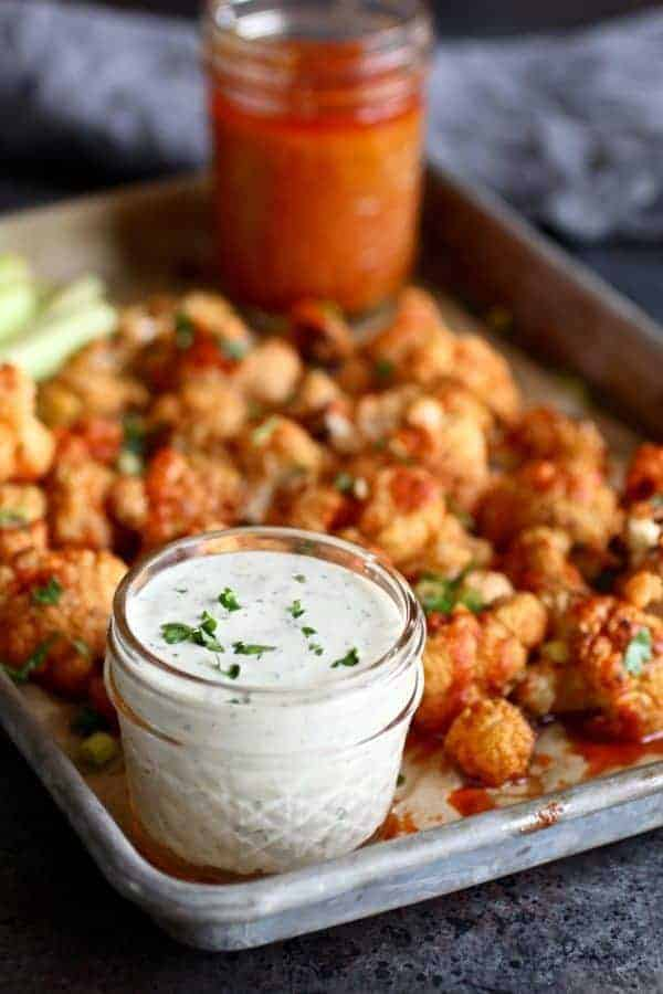 Cauliflower Buffalo Bites (Whole30) | Whole30 appetizers | Whole30 game day recipes | gluten-free appetizer recipes | gluten-free game day recipes | paleo appetizer recipes | paleo game day recipes | dairy-free appetizers | dairy-free game day recipes | homemade cauliflower recipes | healthy cauliflower recipes | healthy appetizers | healthy game day recipes || The Real Food Dietitians