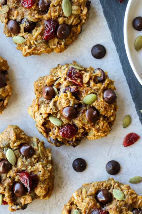 A close view of oatmeal breakfast cookies topped with chocolate chips and dried cranberries.