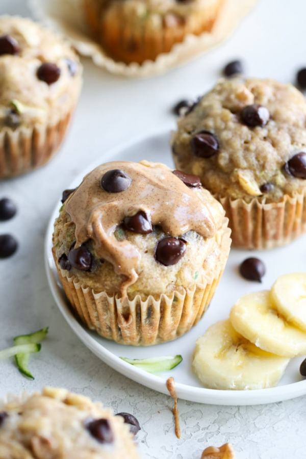 Photo of Gluten-free Chocolate Chip Zucchini Muffins with almond butter drizzled over top.