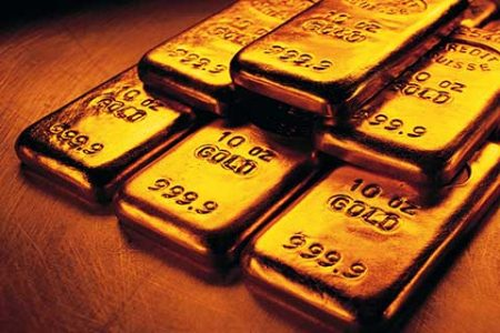 Gold marginally lower; silver tumbles Rs 515