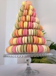 pink, green, yellow, cream and orange macarons on wedding tower