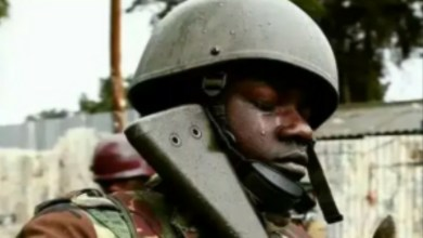 Photo of Nigerian soldier 'kills mother because she's a witch'