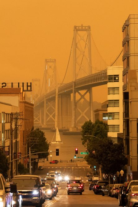 The Bay Bridge is seen under an orange sky darkened by the smoke from California wildfires in San Francisco, California, U.S., September 9, 2020. REUTERS/Stephen Lam